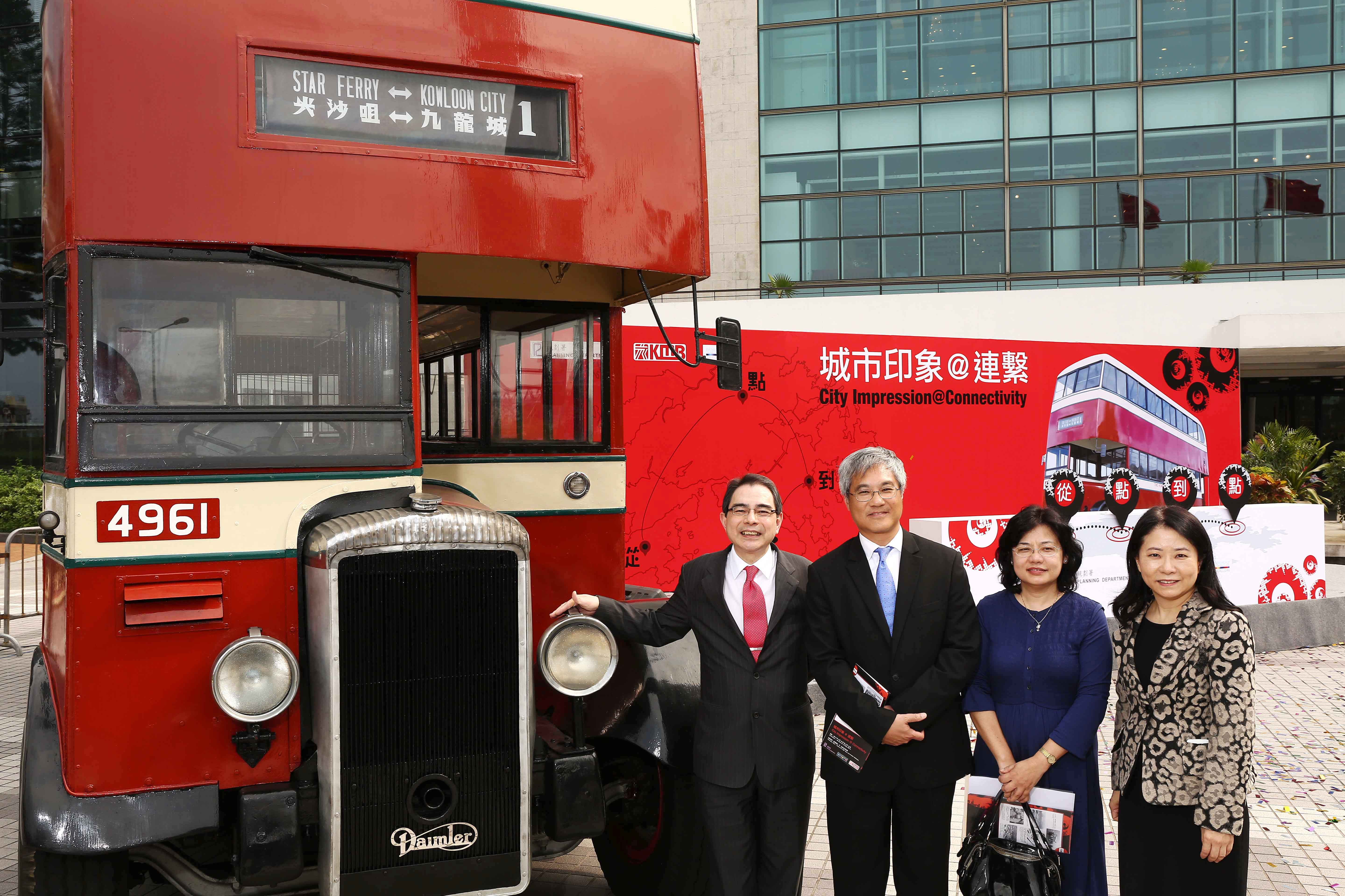 The vintage Daimler A bus is the highlight of the exhibition. Officiating guests (from left to right) KMB Managing Director Mr. Edmond Ho, Director of Planning Mr. KK Ling, Deputy Director of Planning Ms Phyllis Li and KMB Corporate Affairs Director Vivien Chan in front of the vintage bus.